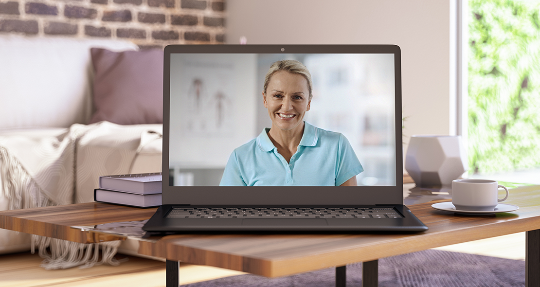 Telerehab doctor on laptop screen